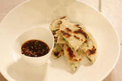 Crispy scallion pancakes with zesty ginger dipping sauce